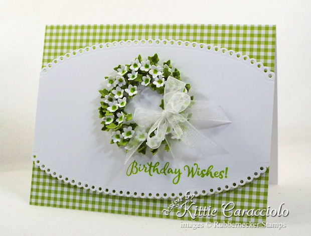 Come see how I made this clean and simple paper flower wreath card.
