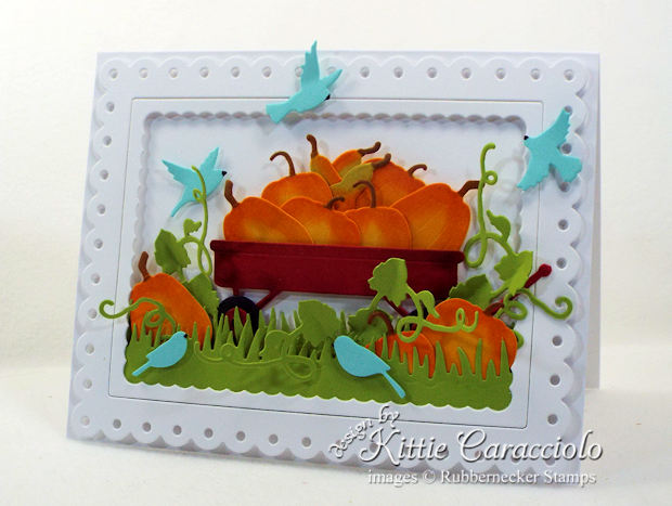 Come see how I made this pumpkin wagon scene card.