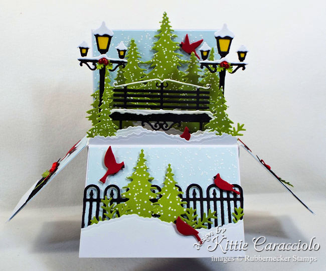 Come over to my blog to see how I made this holiday pop up box card.