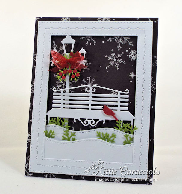 Come see how I made this black and white Christmas card with touches of red and green.
