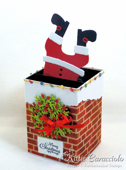 Come see how I made this fun Santa stuck in the chimney box card.