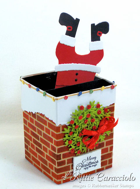 Come see how I made this funny Santa stuck in the chimney box card.