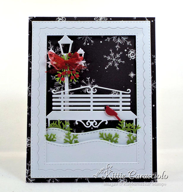 Come see how I made this lovely black and white Christmas card with touches of red and green.