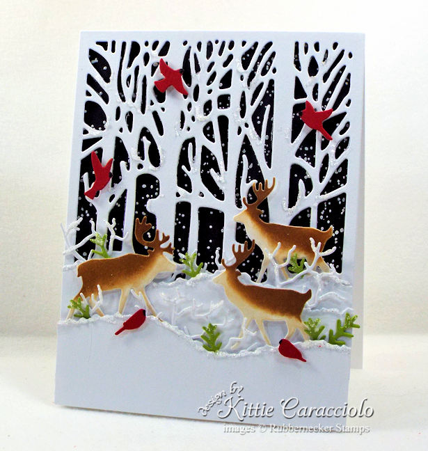 Come see how I made this nature Christmas card with deer and cardinals.
