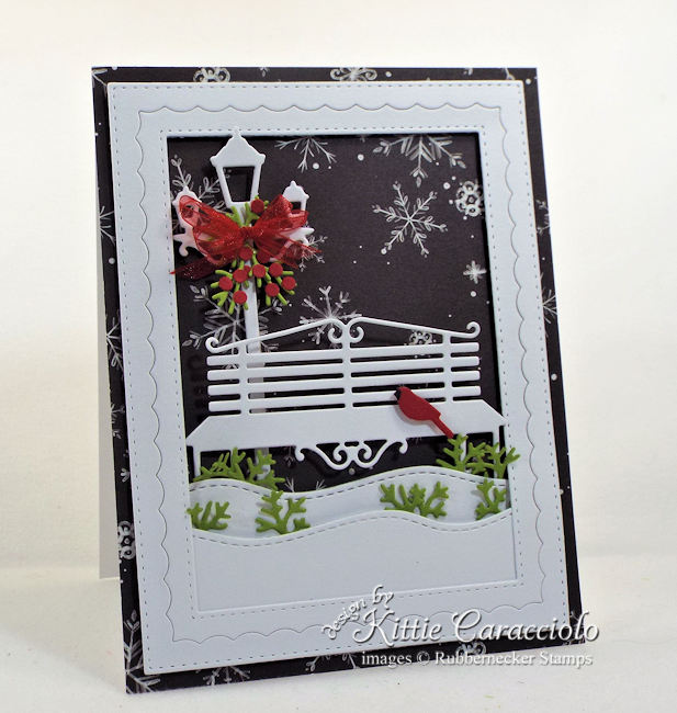 Come see how I made this pretty black and white Christmas card with touches of red and green.