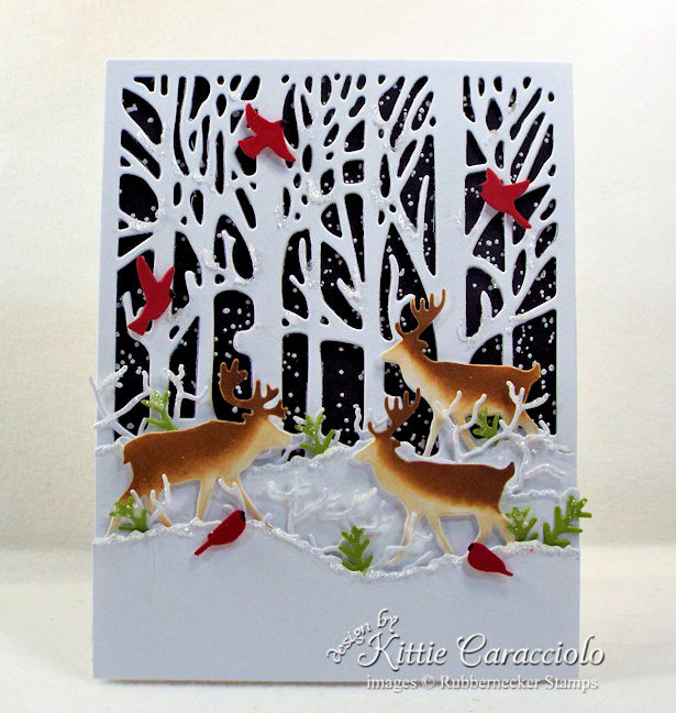 Come see how I made this snowy nature Christmas card with deer and cardinals.