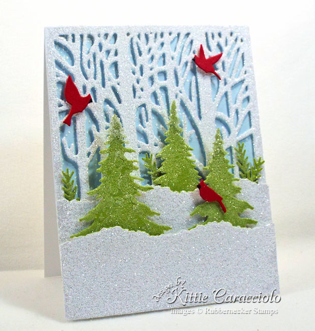Come see how I made this sparkly winter scene Christmas card.