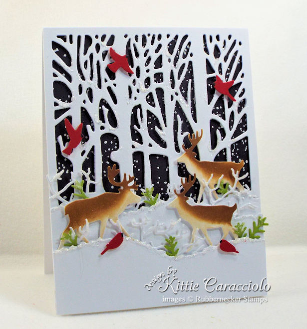 Come see how I made this winter nature Christmas card with deer and cardinals.