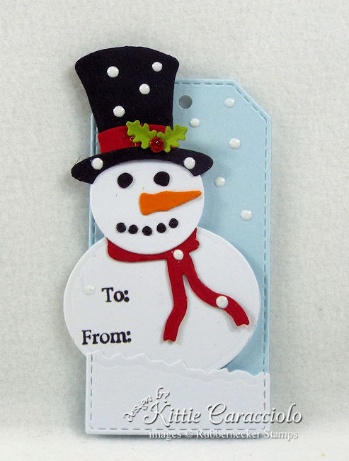 Come see how I made this fun snowman Christmas tag.