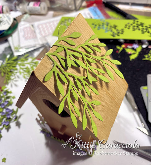 Click thru to see how I embellished a decorative bird house with paper flowers and foliage.