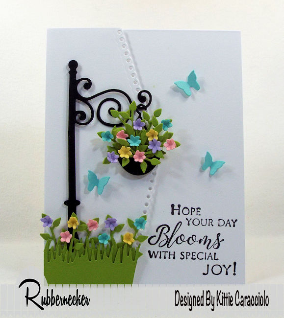 I love using spring flower blooms on my cards with an all white background that allows the colors to pop.  Click thru to see how I made this colorful scene.