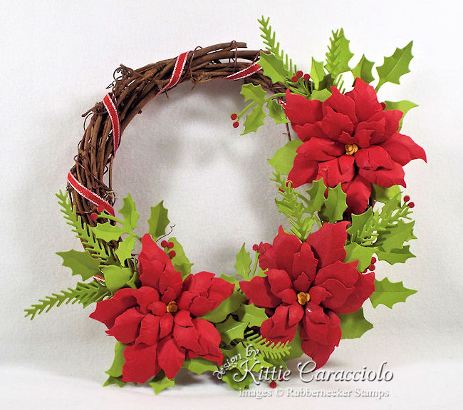 You can see all the details about how I made this paper poinsettia wreath on my blog. Click through to see the details.