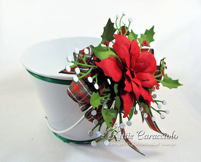 Click thru to see how I decorated this Christmas cookie bucket with ribbon and poinsettia.