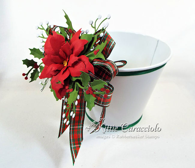Click thru to see how I decorated this pretty Christmas cookie bucket with ribbon and poinsettia.