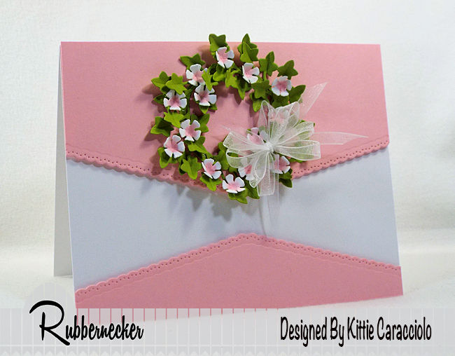 KC Rubbernecker 5162-02D Large Ivy 2 centerI love creating a mini green wreath with pretty paper flowers on a clean and simple card background. Click thru to see how I made this pretty wreath.