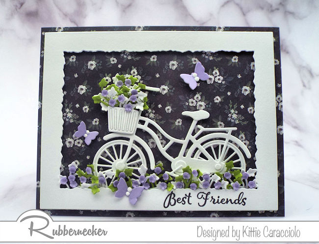 Click thru to check out how I made this white bicycle silhouette card with a pretty designer paper background and paper flowers.