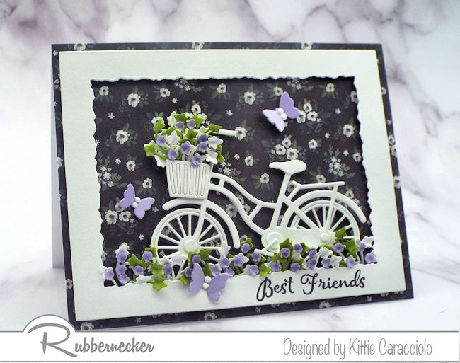Click thru to check out how I made this white bicycle silhouette card with a designer paper background and paper flowers.