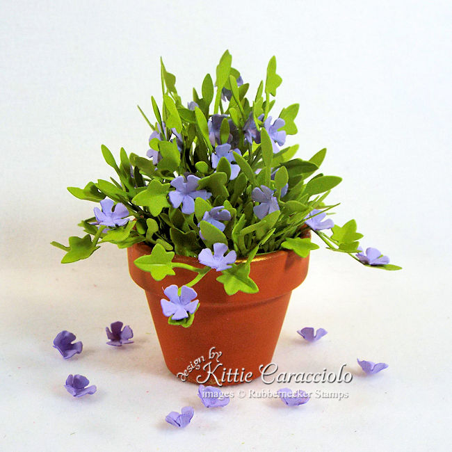 """I'm sharing a mini terracotta pot with paper flowers and foliage in my """"anything but a card"""" series. Click thru to see how I made this petty arrangement."""