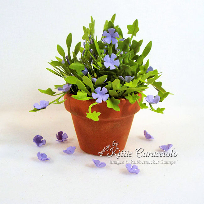 """I'm sharing a mini terracotta pot with paper flowers and foliage in my """"anything but a card"""" series. Click thru to see how I made this cute arrangement."""