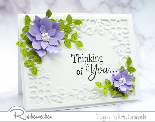 Come check out how I made this elegant paper flower card using poinsettia and floral frame dies made by Rubbernecker.