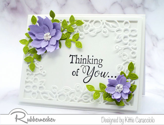 Come check out how I made this elegant spring paper flower card using poinsettia and floral frame dies made by Rubbernecker.