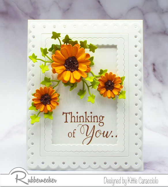 I love adding dimensional paper flowers to my clean and simple cards. Click through to see how I made my flowers.