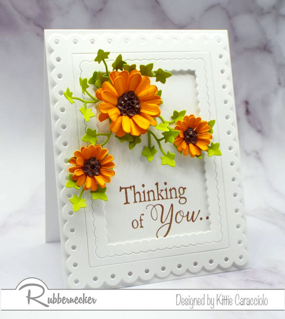 Dimensional paper flowers add so much interest to a clean and simple card. Click over to see how I formed my flowers.