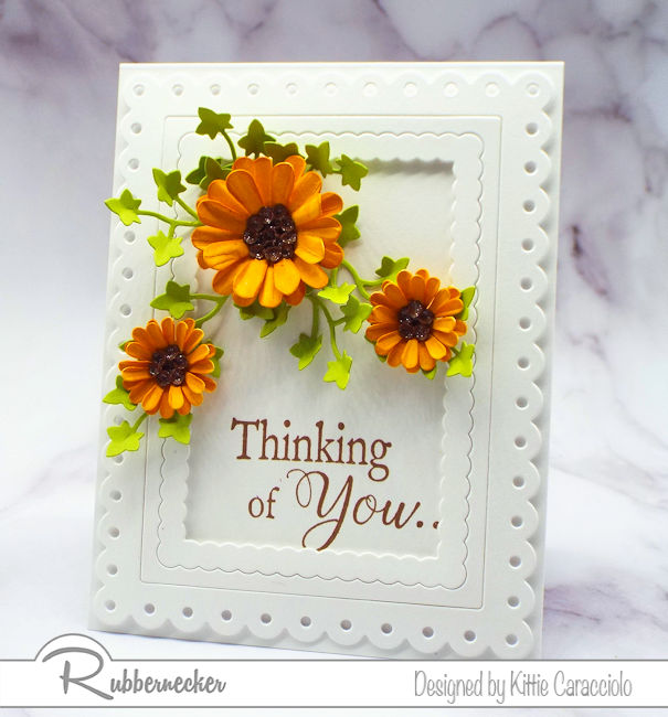 Adding dimensional paper flowers to a clean and simple card really kicks the interest up a notch. Click through to see how I formed my flowers.