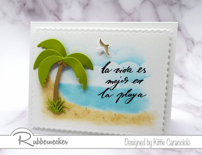 Come see my pretty beach card made using one of the Spanish phrases from Rubbernecker's new Frases en Espanol #1 clear set.