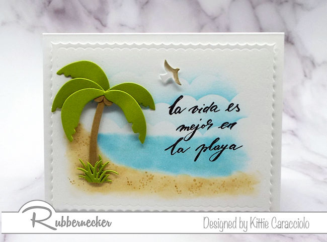 Come check out my pretty beach card made using one of the Spanish phrases from Rubbernecker's new Frases en Espanol #1 clear set.