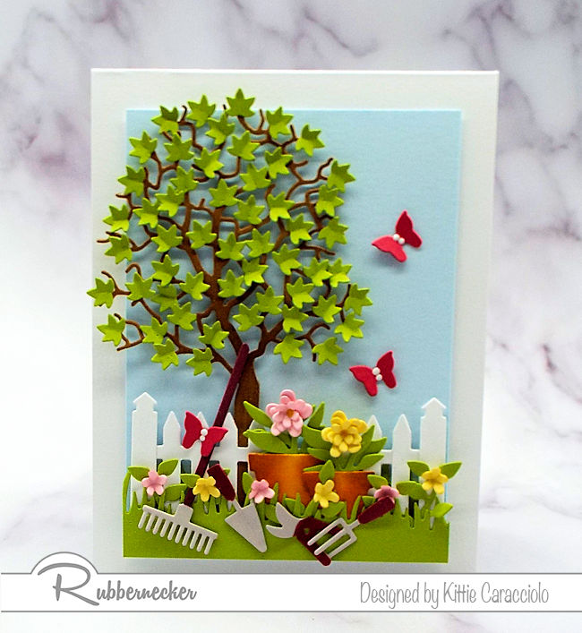 It was so much fun to create this garden tools dies card with the pretty flower pots and leafy tree. Click thru to see how I created this cheerful scene.