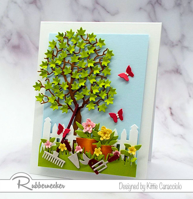It was so much fun to create this garden tools dies card with the pretty flower pots. Click thru to see how I created this cheerful scene.