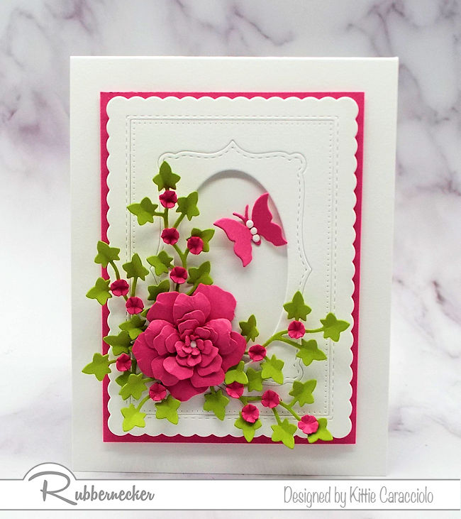 Bright paper flowers are the perfect focal image on an all white card front. Click on the photo to come over to see how I made this lovely card.