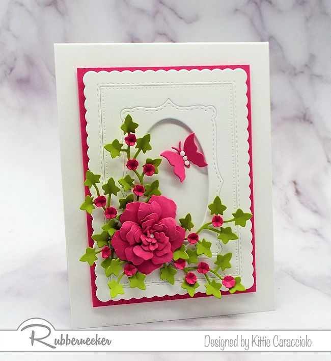 Bright paper flowers are the perfect focal image on an all white card front. Click on the photo to come over to see how I made this colorful card.