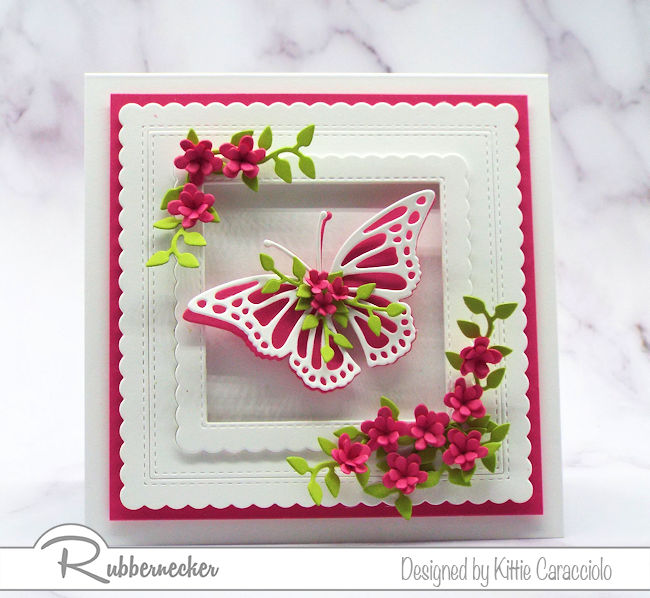 Click on the picture to see how I made this beautiful framed floral embellished butterfly greeting card and foliage using dies by Rubbernecker.