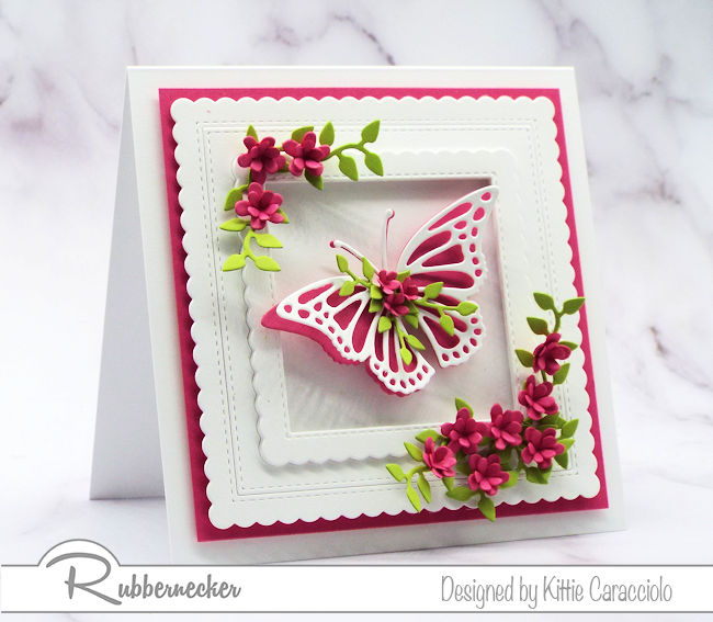 Click on the photo to see how I made this beautiful framed floral embellished butterfly greeting card and foliage using dies by Rubbernecker.
