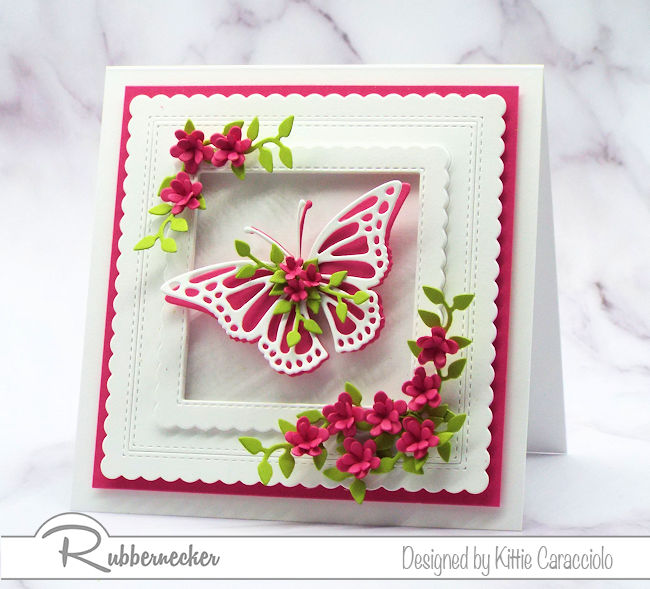 Click through to see how I made this beautiful framed floral embellished butterfly greeting card and foliage using dies by Rubbernecker.