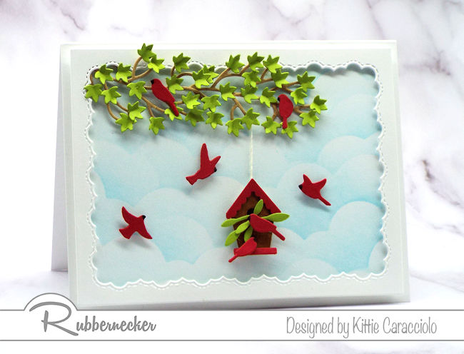 Come over to my blog to see how I made this framed birds and birdhouse card with the pretty blue sky background using dies made by Rubbernecker.
