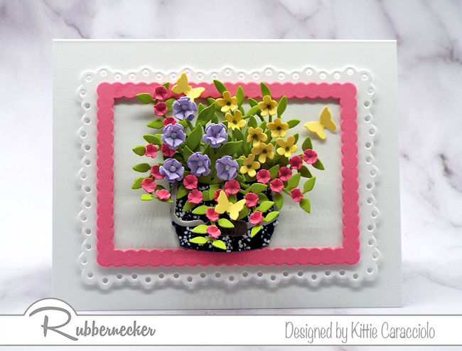 Click on the photo to check out how I use flower arranging with die cuts to create lifelike floral designs using Rubbernecker dies.
