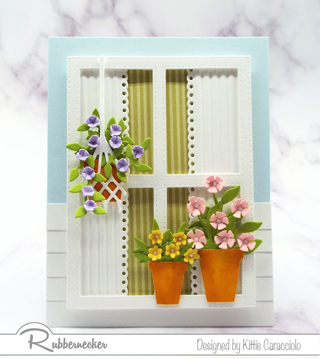 Using a window with flowers on a card front has become so popular. Come over to my blog to see how I made this window scene using dies by Rubbernecker.
