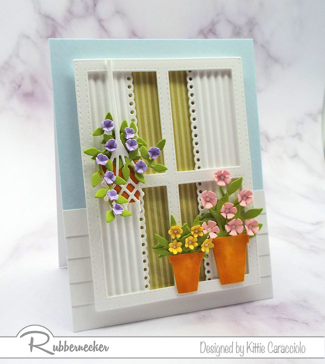 Using a window with flowers on a card front has become so popular. Click on the picture to see how I made this scene using dies by Rubbernecker.