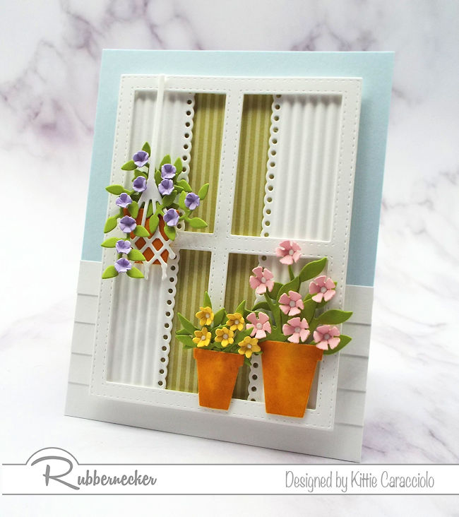 Using a window with flowers on a card front has become so popular. Come over to my blog to see how I made this scene using dies by Rubbernecker.