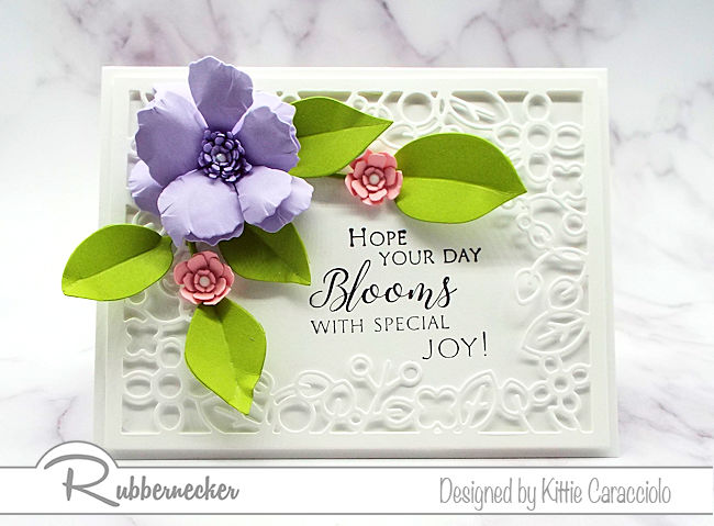 Click on the photo to come over and see how I framed a sentiment with a floral frame, flowers and foliage using dies by Rubbernecker.