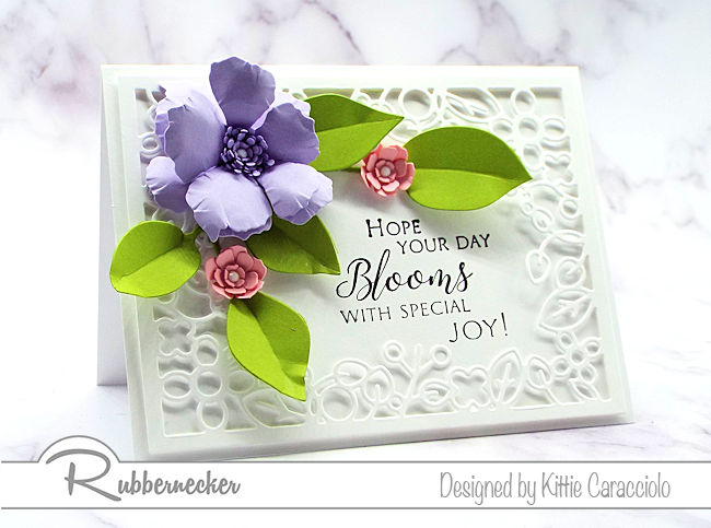 Click on the picture to come over and see how I framed a sentiment with a floral frame, flowers and foliage using dies by Rubbernecker.