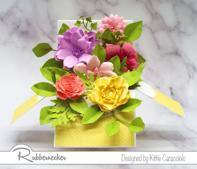 Create a paper flower pop up box with left over flowers from past projects.  Click on the picture to see how I made this card with flowers from my stash.