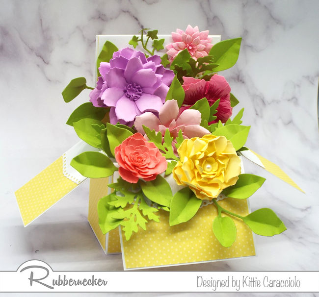 Create a paper flower pop up box with left over flowers from past projects.  Come over to see how I made this card with flowers from my stash.