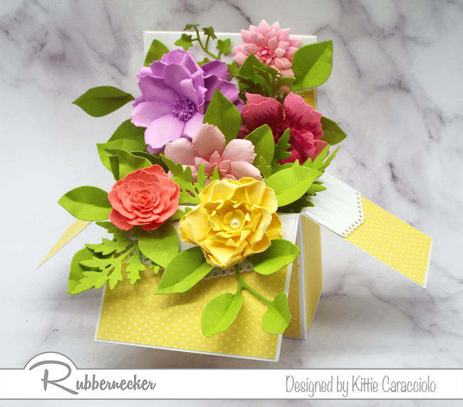 Create a paper flower pop up box with left over flowers from past projects.  Click on the photo to see how I made this card with flowers from my stash.