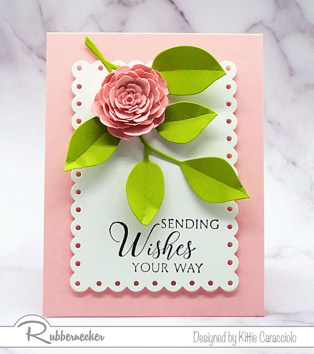 Come over to see how I made this pretty clean and simple flower card using a die cut flower and foliage on a decorative white background.