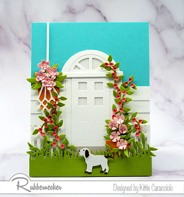 Door cards have become very popular in paper crafting. It's fun to embellish the door with flowers and foliage to create a welcoming scene.