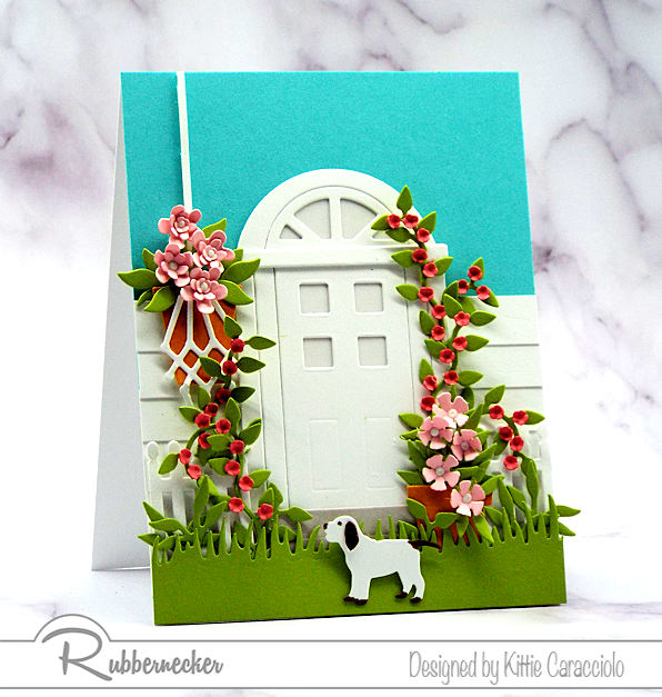 Door cards have become very popular in paper crafting. It's fun to embellish the door with flowers, foliage and a pet to create a welcoming scene.
